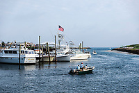 Charter fishing boats leaving Sesuit Harbor, Dennis, Massachusetts, USA.