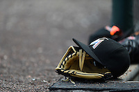 Miami Marlins hat and glove on the dugout step during a Spring Training game against the Detroit Tigers on March 25, 2015 at Joker Marchant Stadium in Lakeland, Florida.  Detroit defeated Miami 8-4.  (Mike Janes/Four Seam Images)