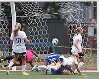Boston Breakers forward Lianne Sanderson (10) from the ground watches her drive complete in a score. In a National Women's Soccer League (NWSL) match, Portland Thorns FC (white) defeated Boston Breakers (blue), 2-1, at Dilboy Stadium on July 21, 2013.