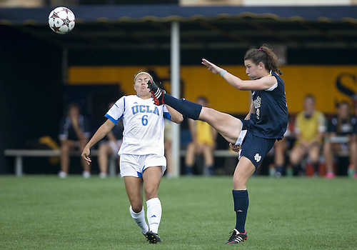 September 01, 2013:  Notre Dame midfielder Morgan Andrews (#3) kicks the ball as UCLA midfielder Lauren Kaskie (#6) defends during NCAA Soccer match between the Notre Dame Fighting Irish and the UCLA Bruins at Alumni Stadium in South Bend, Indiana.  UCLA defeated Notre Dame 1-0.
