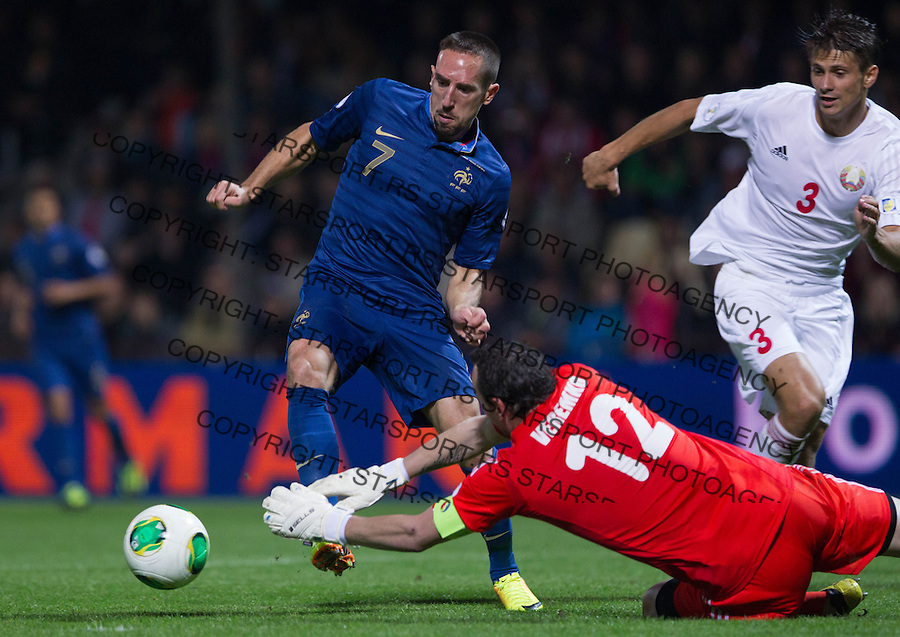 Fudbal Soccer<br /> World Cup 2014 qualifiers match<br /> Belarus v France<br /> Frenck Ribery (L) goalkeeper Sergei Veremko and Alexander Martynovich (R)<br /> Gomel, 06.09.2013.<br /> foto: Srdjan Stevanovic/Starsportphoto &copy;