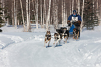 Jennifer Sterling drives a 6 dog team in the 2009 Limited North American sprint sled dog race, Fairbanks, Alaska.