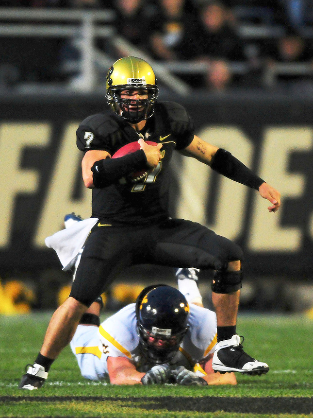 18 September 08: Colorado quarterback Cody Hawkins rushes against West Virginia. The Colorado Buffaloes defeated the West Virginia Mountaineers 17-14 in overtime at Folsom Field in Boulder, Colorado. For Editorial Use Only.
