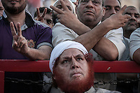 In this Monday, Aug. 12, 2013 photo, supporters of the ousted president Mohammed Morsi gather at the streets around Al-Raba'a Alawya as they prepare themselves to stand after Ministry of Interior stated the clearing up of the sit-in in Nasr City neighbourhood of Cairo. (Photo/Narciso Contreras).