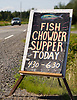 In Hall's Harbour, Nova Scotia, a sign announces a seafood dinner at the local volunteer fire department. Photo by Kevin J. Miyazaki/Redux