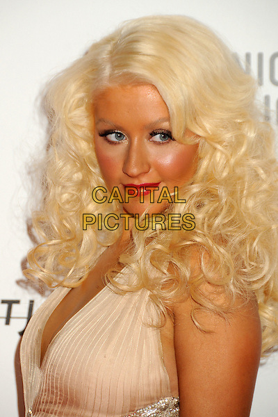 "CHRISTINA AGUILERA .at LACMA's ""The Unmasking"" The Lynda & Stewart Resnick Exhibition Pavilion Opening Gala at The Los Angeles County Museum of Art in Los Angeles, California, USA, September 25th 2010..portrait headshot make-up beauty tanned halterneck silk chiffon  side .CAP/ADM/BP.©Byron Purvis/AdMedia/Capital Pictures."