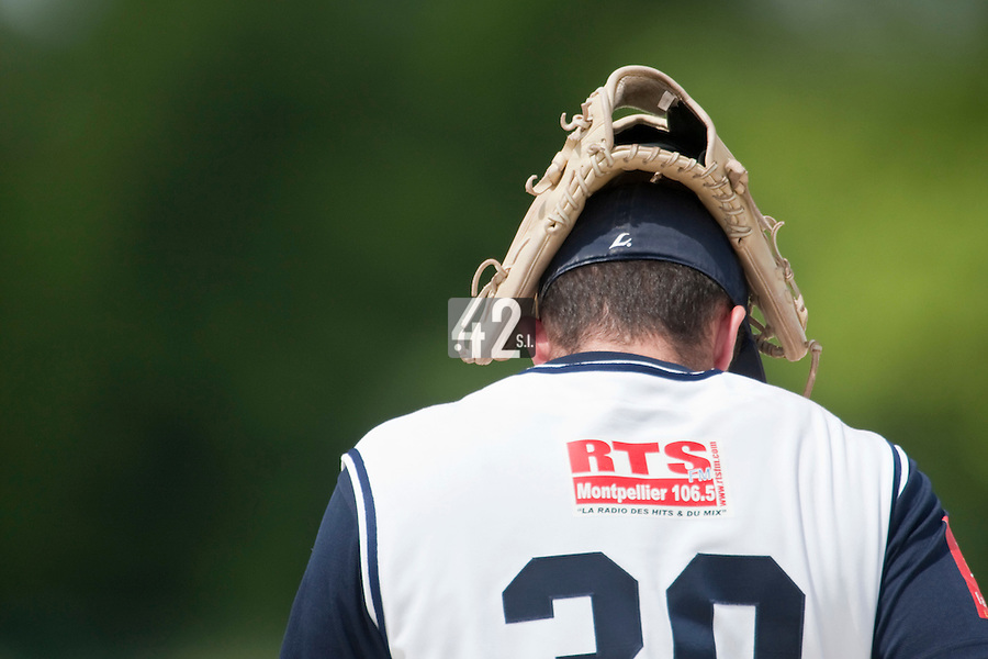 22 May 2009: Stefan Farget of Montpellier puts his glove on his head during the 2009 challenge de France, a tournament with the best French baseball teams - all eight elite league clubs - to determine a spot in the European Cup next year, at Montpellier, France. Senart wins 7-1 over Montpellier.