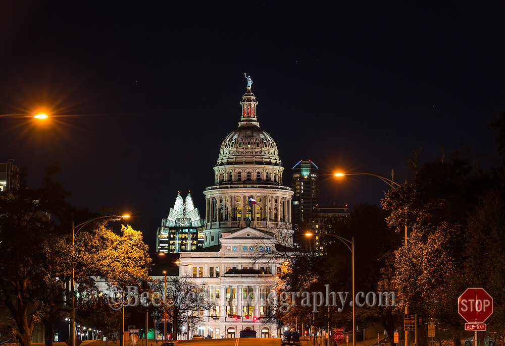 This is image of the Texas State Capitol in Austin Texas with the city skyline in the background at night. The two buildings you can see in the background are the Frost and the Austonian which are iconic images in the city.