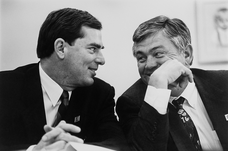 Rep. Bill Sarpalius, D-Tex., and Rep. William K. Brewster, D-Okla., sharing a laugh at Appropriations/Health and Human Services hearing regarding the impact of aid on May 06, 1992. (Photo by Maureen Keating/CQ Roll Call)