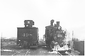 Head-on view of D&amp;RGW #278 and rear tender view of #498 side-by-side at Gunnison.<br /> D&amp;RGW  Gunnison, CO  3/30/1949