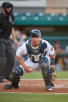 Lakeland Flying Tigers catcher Austin Athmann (19) keeps an eye on a baserunner during a game against the Fort Myers Miracle on August 7, 2018 at Publix Field at Joker Marchant Stadium in Lakeland, Florida.  Fort Myers defeated Lakeland 5-0.  (Mike Janes/Four Seam Images)