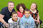 Mag O'Leary, Gneeveguilla, along with her children Ross, Paudie and Antonette who made a presentation to the Kerry Stars of a cheque of ?4049.02 pictured with Paudie Healy, Kerry Stars, in Spa Clubhouse, Killarney on Monday evening. ..............................................