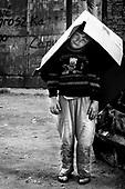 Wroclaw 23.05.2006 Poland<br /> Children playing on the refuse heap<br /> The worst and the most dangerous district in Wroclaw ( Poland ) , called by people &quot;The Bermuda Triangle&quot;. There are walls bearing an inscription &quot;Who will enter here, will not exit alive&quot; Many families there are pathological and live in extreme poverty. Children have no place for any games so they loaf around on this wasted district and disseminate a juvenile delinquency. Many of them become sexually active though they are only 10-12 years old<br /> (Photo by Adam Lach / Napo Images)<br /> <br /> Najbardziej nabezpieczna dzielnica we Wroclawiu zwana przez ludzi Trojkatem Bermudzkim. Sa tam sciany opatrzone napisem &quot; Kto tu wejdzie, nigdy nie wyjdzie stad zywy&quot; Mieszka tam wiele rodzin patologicznych i zyja w wielkiej nedzy. Dzieci wlocza sie po ulicach nie majac miejsc na zabawe i szerza przestepczosc wsrod nieletnich. Wiele z dzieci uprawia seks choc maja zaledwie 10-12 lat<br /> (Fot Adam Lach / Napo Images)