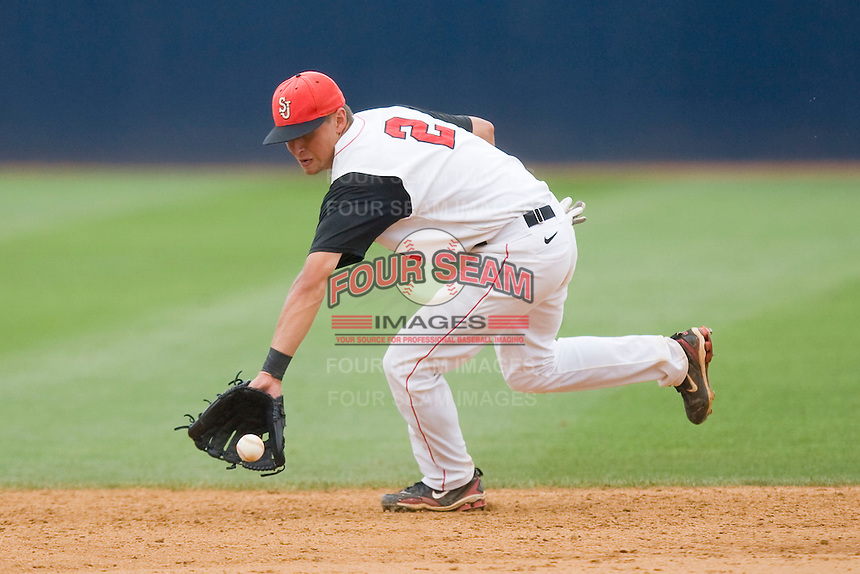Shortstop Joe Panik #2 of the St. John's Red Storm backhands a ground ball against the Ole Miss Rebels at the Charlottesville Regional of the 2010 College World Series at Davenport Field on June 6, 2010, in Charlottesville, Virginia.  The Red Storm defeated the Rebels 20-16.  Photo by Brian Westerholt / Four Seam Images