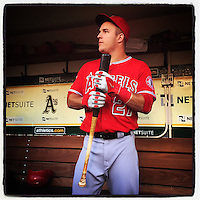 OAKLAND, CA - SEPTEMBER 22: Instagram of 20-year-old rookie Mike Trout of Los Angeles Angels standing in the dugout before the game against Oakland Athletics at O.co Coliseum on September 22, 2014 in Oakland, California. Photo by Brad Mangin