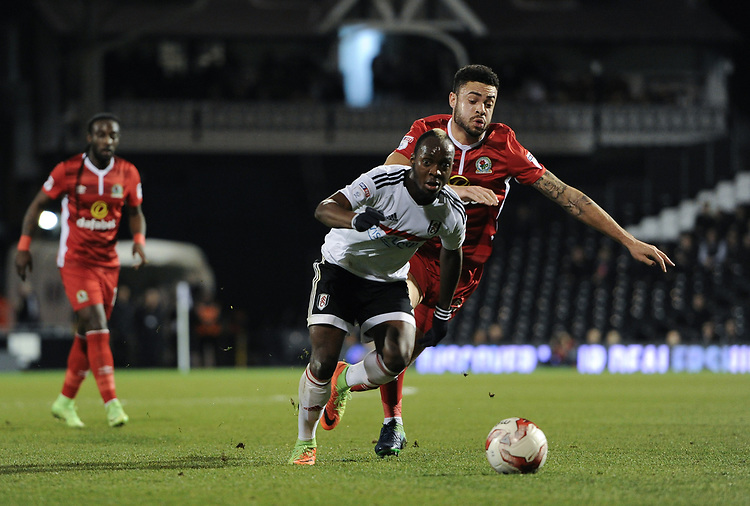 Fulham's Neeskens Kebano holds off the challenge from Blackburn Rovers' Derrick Williams<br /> <br /> Photographer /Ashley WesternCameraSport<br /> <br /> The EFL Sky Bet Championship - Fulham v Blackburn Rovers - Tuesday 14th March 2017 - Craven Cottage - London<br /> <br /> World Copyright &copy; 2017 CameraSport. All rights reserved. 43 Linden Ave. Countesthorpe. Leicester. England. LE8 5PG - Tel: +44 (0) 116 277 4147 - admin@camerasport.com - www.camerasport.com