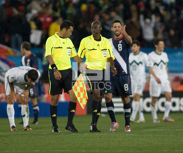 The USA's Clint Dempsey gestures at Referee Koman Coulibaly (center) after the end of the 2010 World Cup match between USA and Slovenia at Ellis Park Stadium in Johannesburg, South Africa on Friday, June 18, 2010.  The USA tied Slovenia 2-2.