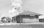D&amp;RGW Rotary #OY train headed west passing Antonito depot.<br /> D&amp;RGW  Antonito, CO  Taken by Richardson, Robert W. - 2/19/1952