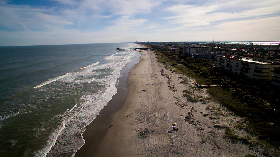 Waves from the Atlantic Ocean wash ashore on Wednesday, Jan. 17, 2018, in Cocoa Beach, Florida. Pictured in the distance is the Cocoa Beach Pier. (Photo by James Brosher)