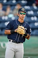 Second baseman Oswaldo Cabrera (10) of the Charleston RiverDogs warms up before a game against the Greenville Drive on Friday, April 27, 2018, at Fluor Field at the West End in Greenville, South Carolina. Greenville won, 5-4. (Tom Priddy/Four Seam Images)