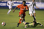 Virginia's Ryan Burke (r) punches the ball away from Clemson's Dane Richards (10) on Wednesday, November 9th, 2005 at SAS Stadium in Cary, North Carolina. The Clemson Tigers defeated the University of Virginia Cavaliers 4-1 during their Atlantic Coast Conference Tournament Quarterfinal game.