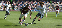 Burnley's Andre Gray and Manchester United's Marouane Fellaini<br /> <br /> Photographer Stephen White/CameraSport<br /> <br /> The Premier League - Burnley v Manchester United - Sunday 23rd April 2017 - Turf Moor - Burnley<br /> <br /> World Copyright &copy; 2017 CameraSport. All rights reserved. 43 Linden Ave. Countesthorpe. Leicester. England. LE8 5PG - Tel: +44 (0) 116 277 4147 - admin@camerasport.com - www.camerasport.com