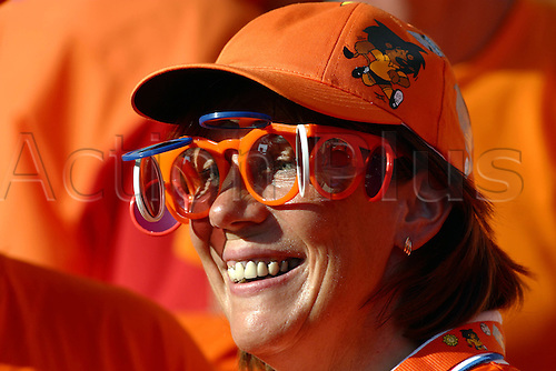 15 June 2004: A Dutch fan enjoying the atmosphere before the Euro 2004 Group D match between Germany and Holland at the Estadio do Dragao, Porto. The match ended in a 1-1 draw. Photo: Glyn Kirk/actionplus..040615 football soccer crowd supporter spectator netherlands female woman women