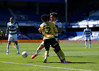 18th July 2020; The Kiyan Prince Foundation Stadium, London, England; English Championship Football, Queen Park Rangers versus Millwall; Ryan Manning of Queens Park Rangers grapples with Mahlon Romeo of Millwall
