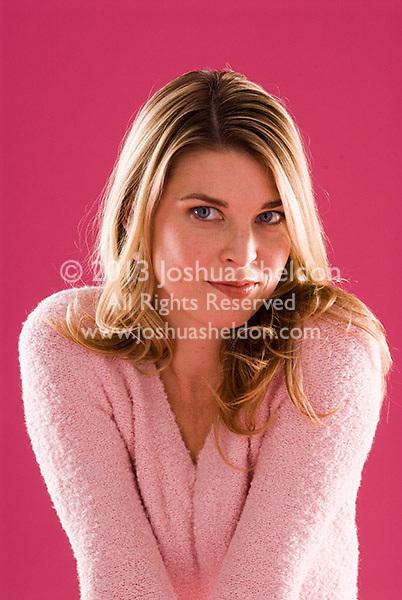 Studio portrait of young blonde Caucasian woman