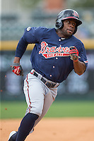 Eric Young Jr. (14) of the Gwinnett Braves rounds third base during the game against the Charlotte Knights at BB&T BallPark on July 3, 2015 in Charlotte, North Carolina.  The Braves defeated the Knights 11-4 in game one of a day-night double header.  (Brian Westerholt/Four Seam Images)