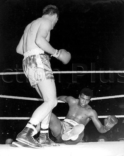 18.06.1963. Wembley Arena, London England. Henry Cooper puts his famous 'henries hammer' on the chin of Cassius Clay at the end of the fourth round of their fight at Wembley, London. Ali dominated the boxing rings of the world except for one moment in June when Henry Cooper British and Empire Heavyweight Champion put him on the canvas. Muhammad Ali died on June 3rd 2016 of a respiratory complication in a Phoenix hospital.
