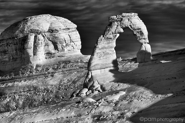 Black and white infrared image of Utah's Delicate Arch at sunrise.
