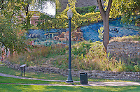 Murals, part of a Public Art project grace the walls of Bicentennial Park in Joliet, Illinois, which lies along the DesPlaines River, across from the downtown area