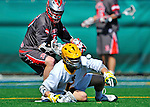 17 March 2012: University of Vermont Catamount Midfielder Andrew Buckanavage, a Freshman from Ridgefield, CT, works a face-off against Sacred Heart University Pioneer Midfielder Parker Wilson, a Senior from Cary, NC, at Virtue Field in Burlington, Vermont. The Catamounts defeated the visiting Pioneers 12-11 with only 10 seconds remaining in their non-conference matchup. Mandatory Credit: Ed Wolfstein Photo