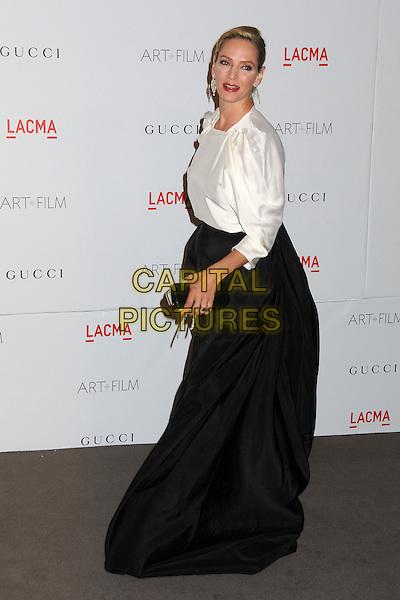 Uma Thurman.The Inaugural Art and Film Gala held at LACMA in Los Angeles, California, USA..November 5th, 2011.full length black skirt clutch bag white side.CAP/ADM/BP.©Byron Purvis/AdMedia/Capital Pictures.