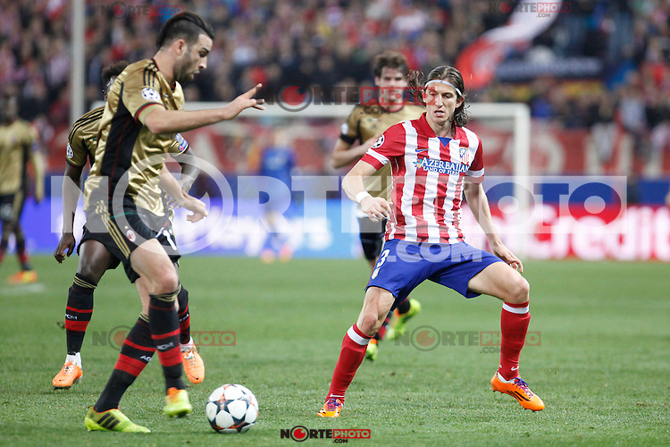 Atletico de Madrid´s Filipe Luis (R) and Milan´s Adil Rami during 16th Champions League soccer match at Vicente Calderon stadium in Madrid, Spain. March 11, 2014. (ALTERPHOTOS/Victor Blanco)
