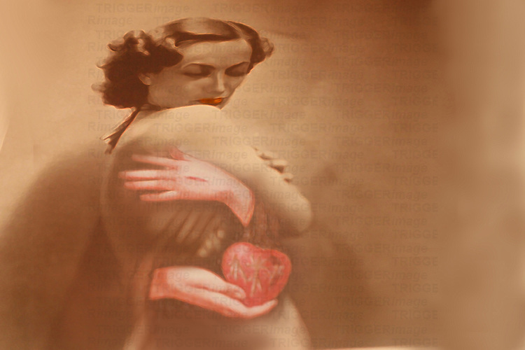 A nostaligic image of a woman and hands holding a red heart