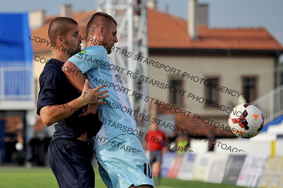 Fudbal Super liga season 2014-2015<br /> Novi Pazar v Rad<br /> Sead Hadzibulic (#10) FK Novi Pazar u duelu sa Nikola Raspopovic (#21) FK Rad<br /> Novi Pazar, 9. 8. 2014<br /> foto: Emir Sadovic/Starsportphoto &copy;