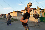 "THIS PHOTO IS AVAILABLE AS A PRINT OR FOR PERSONAL USE. CLICK ON ""ADD TO CART"" TO SEE PRICING OPTIONS.   A man heads a soccer ball while playing football in the street in the largely Roma neighborhood of Gorno Ezerovo, part of the Bulgarian city of Burgas. Residents here don't self-identify much as Roma, because of the negative connotations associated with the word, so many refer to themselves as a Turkish-speaking minority."