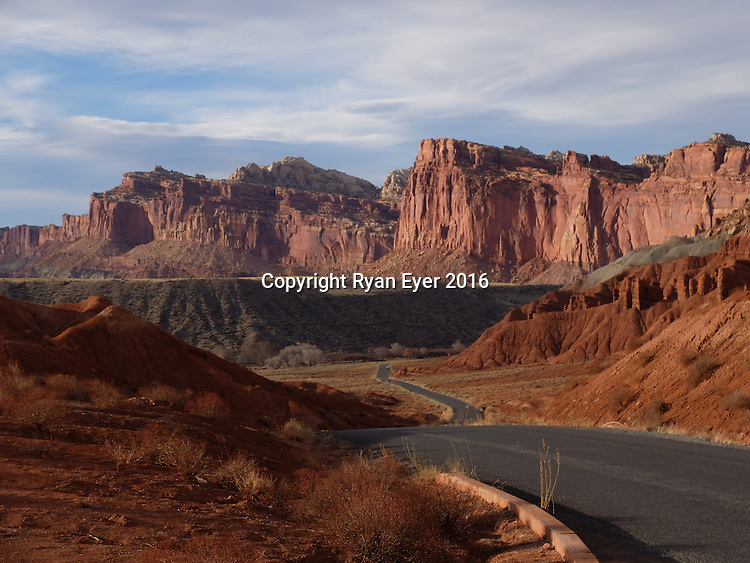 Wayne County - 12 March 2016 - A road through the Capitol Reef National Park in Utah. The park was opened in 1971 and consists of 241,904 acres of desert landscape.