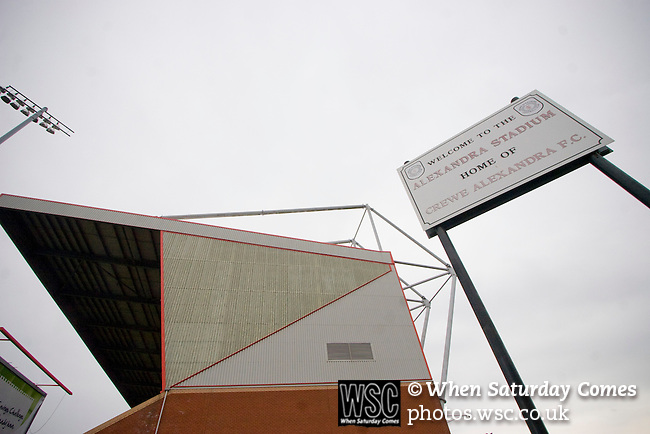 The main stand, also known as the Air Products Stand, which was opened in 1999 dominates the surrounding streets on the day of a League 2 fixture between Crewe Alexandra and Aldershot Town at the Alexandra Stadium. The visitors won by 2 goals to 1.