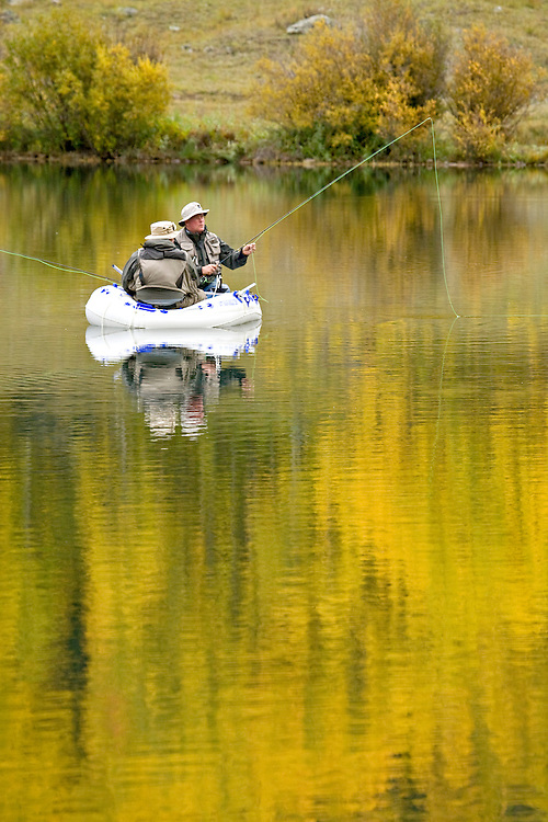 Two adult men fishing in Crystal Lake in autumn near Ouray, Colorado