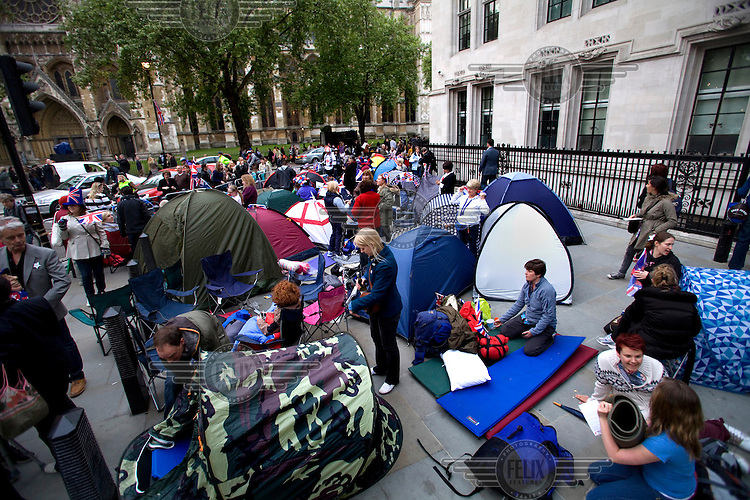 People bag a spot to camp overnight outside Westminster Abbey, London the day before the Royal Wedding between Britain's Prince William and Kate Middleton...