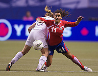 Raquel Rodriguez, right, of Costa Rica tangles with Rachel Buehler of the United States during play in the CONCACAF Olympic Qualifying semifinal match at BC Place in Vancouver, B.C., Canada Friday Jan. 27, 2012. The United States won the match 3-0 to earn a berth in 2012 London Olympics.