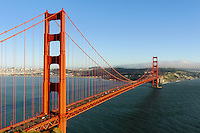 The dominant colors of blue and gold over the Golden Gate Bridge from the Marin headlands
