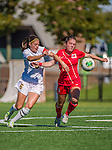 29 September 2013: Stony Brook University Seawolves Midfielder Tessa Devereaux, a Sophomore from Fayetteville, NY, battles University of Vermont Catamount Forward/Defender Haley Marks, a Senior from Penfield, NY, during game action at Virtue Field in Burlington, Vermont. The Lady Seawolves defeated the Catamounts 2-1 in America East play. Mandatory Credit: Ed Wolfstein Photo *** RAW (NEF) Image File Available ***