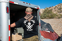The logo of a gun shop in New Hampshire on a shirt worn by Josh Delemus who traveled across the country to join camp &quot;Liberty&quot;.<br />
