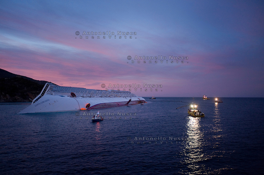 Island of Giglio, Italy, January 21, 2012.  The stricken luxury liner Costa Concordia lies off the Isola del Giglio..