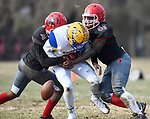 Borgia quarterback Sam Heggemann (center) fumbles the ball as he is tackled by Roosevelt players Paul Strickland (left) and Delane Harris. Roosevelt defeated Borgia in a Class 3 District 2 football game at Roosevelt HS in St. Louis on Saturday November 16, 2019. <br /> Tim Vizer/Special to STLhighschoolsports.com