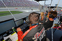 The Phoenix crew keeps an eye on the monitors as their car races by.